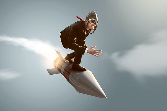 Businessman on a rocket.jpg