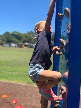 Girl climbing climbing wall.jpg