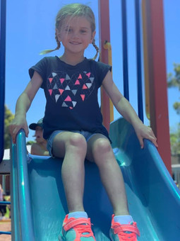 Girl at top of slide.jpg