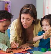 Preschool teacher with children