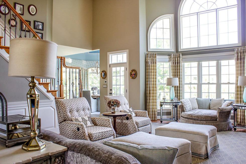 Spacious transitional living room interior