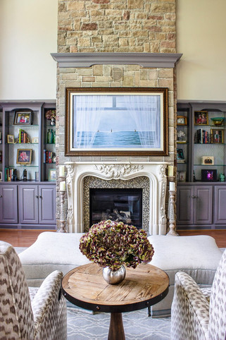 Spacious transitional living room mantle detail