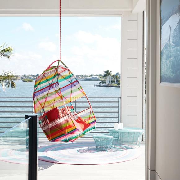 Moroso hanging chair on balcony