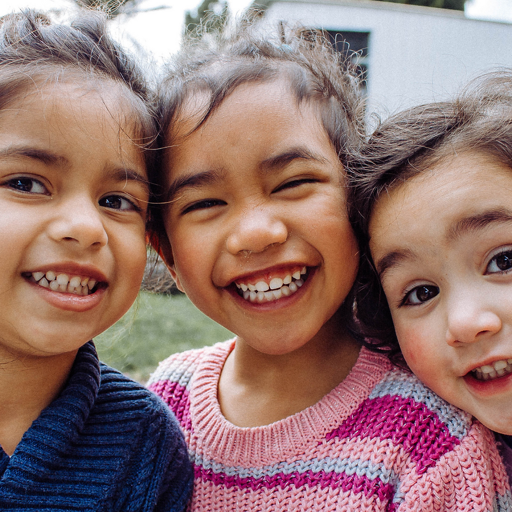 children smiling with friends