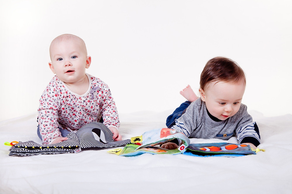 Babies Playing With Books
