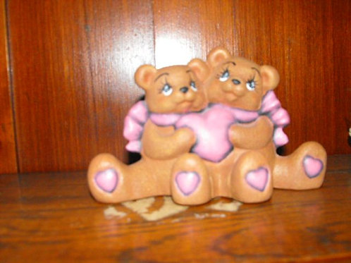 Cuddle bears holding heart