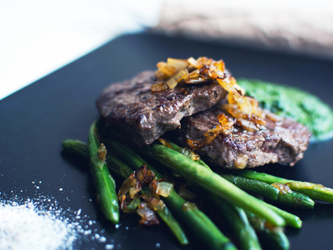 Skirt steak with caramelized onions and chimichurri drizzle