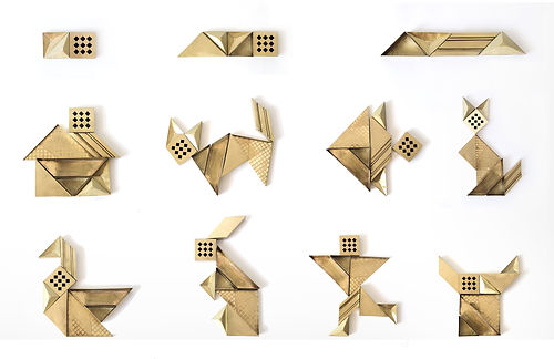 Thaigram is a combination of a table organiser set and a puzzle game. The product is entirely made of recycled and hand-shaped brass by local artisans in Thailand.