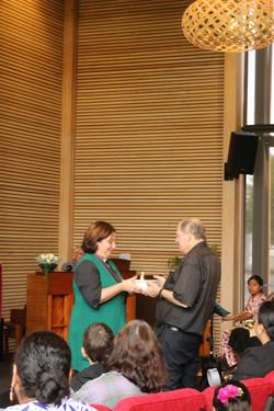 Rev. Anne Preston gifting Property Manager Neville Jack gift of thanks