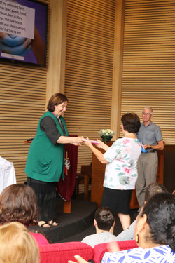 Naomi Jack being presented a thank you gift by Rev. Anne