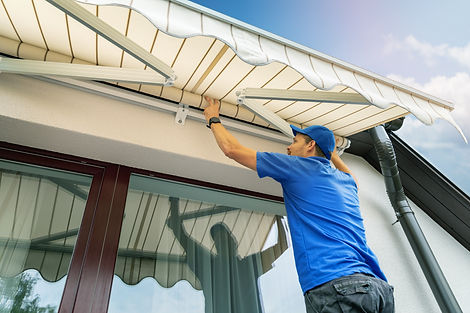 worker install an awning on the house wa