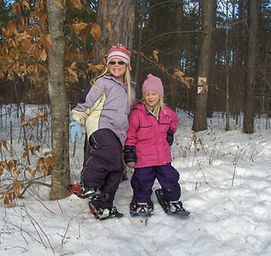 Image of Students with Snowshoes in the Forest