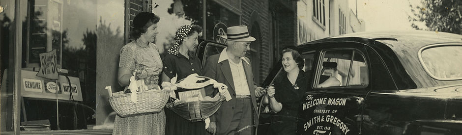 Smith & Gregory Ford Dealers presenting a new car to Bayside Welcome Wagon hostesses, 1950