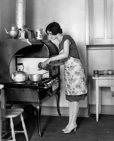 1920s housewife at stove cooking