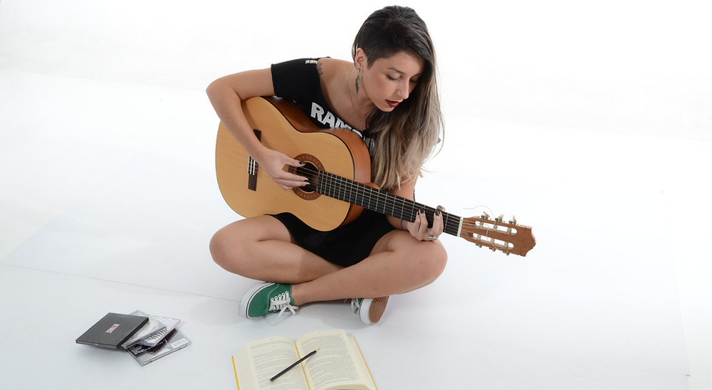 One song can change everything, singing and playing guitar,