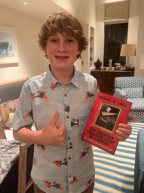 Henry holding a copy of my YA book.