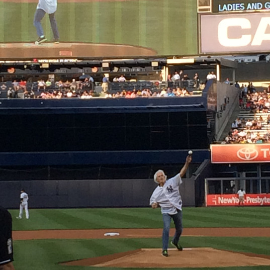 Throwing the first pitch to catcher Brian McCann in front of a full house at Yankee Stadium prior to the start of their game against the Cincinnati Reds. (July 2014)