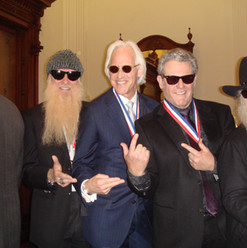 Cutting up at the Texas State Capitol in Austin, alongside ZZ Top's Billy Gibbons and Dusty Hill, and artist James Drake, following presentation of their respective Texas Medal of Arts awards. (March 2011)