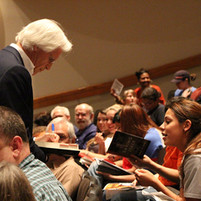 Visiting with students prior to his presentation at Tarrant County College. (October 2013)