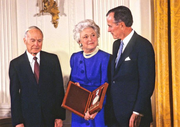 President Bush and First Lady, Barbara Bush, presenting the National Medal of the Arts to Monuments Man Walker Hancock in 1989.