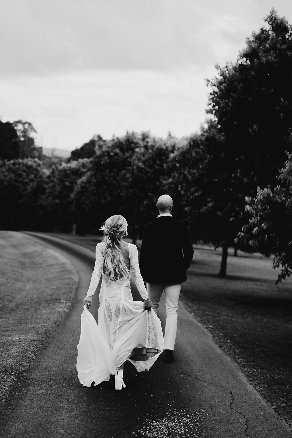 young couple dances after getting married at Graciosa Byron Bay at sunset