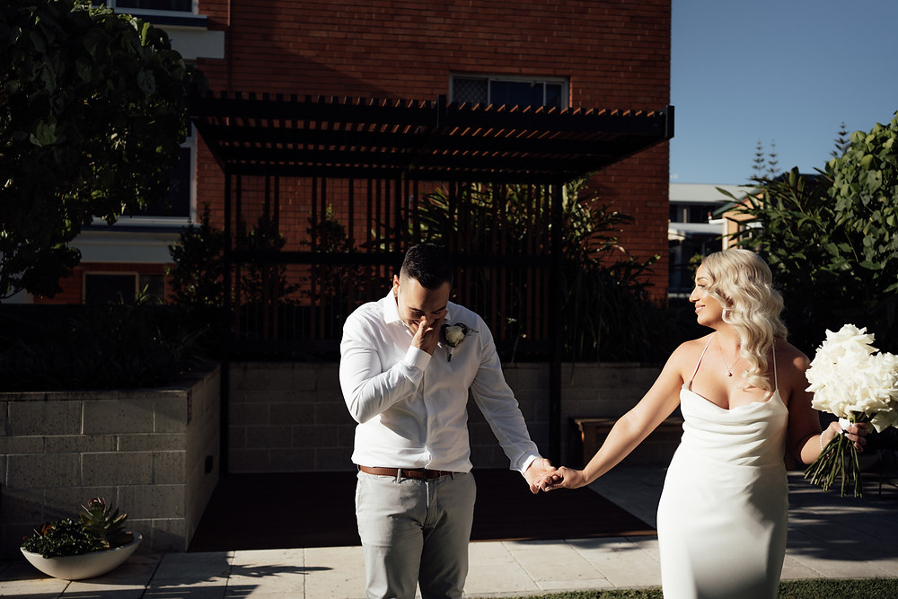First look between bride and groom before their wedding in burleigh