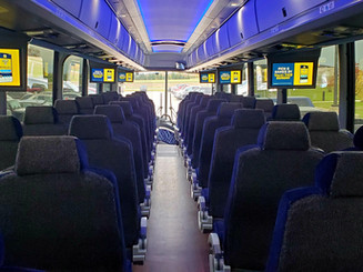 Flat screen monitors on every motorcoach