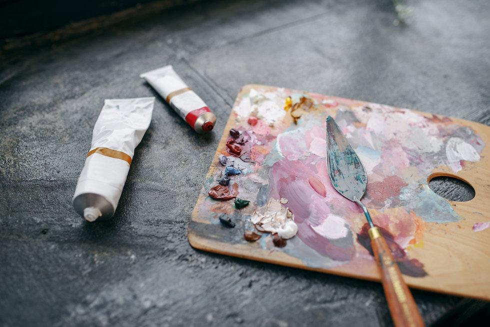 colorful-paints-on-palette-closeup-nobod