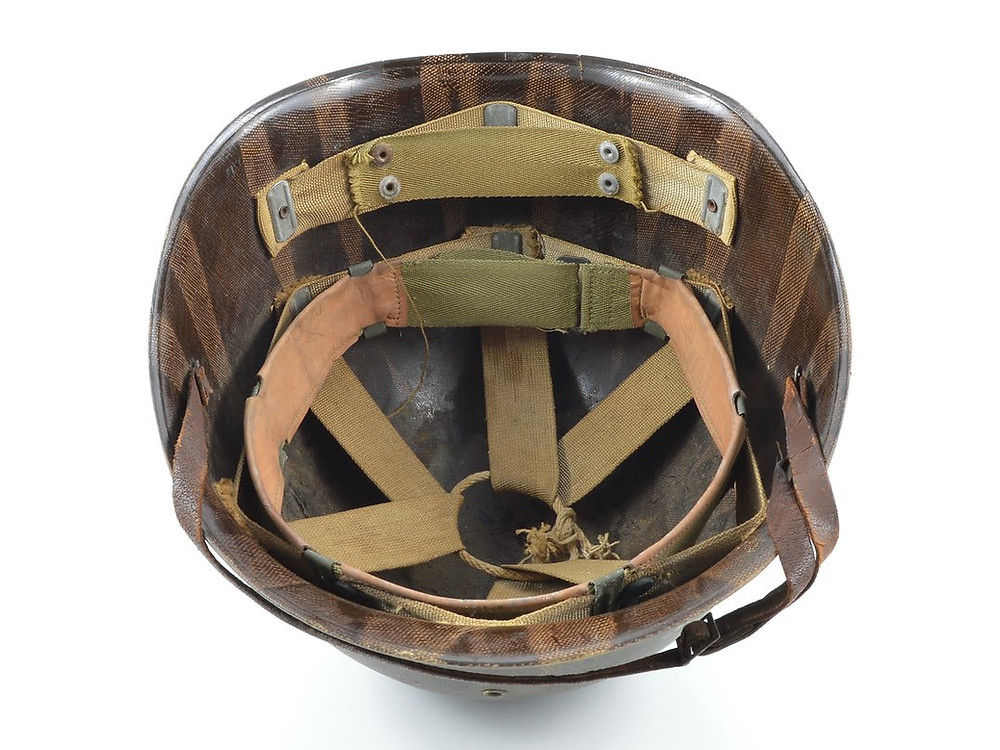A Westinghouse helmet liner with a rayon suspension and later cotton accessories.