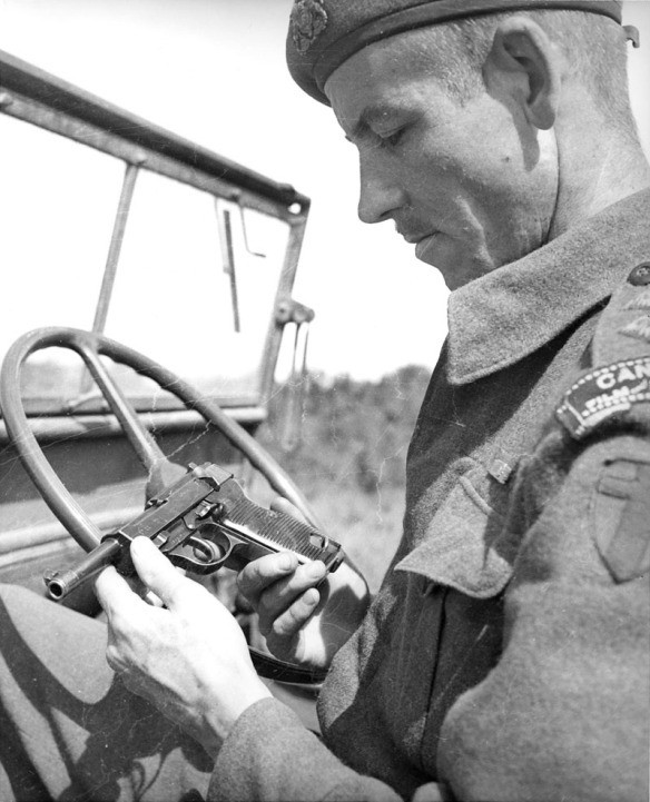 A Canadian solider inspecting a captured P.38.