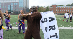 SASSquatch mascot holding flag