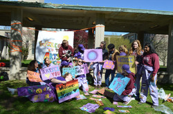 group of students with flag, posters