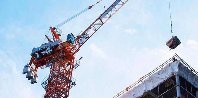 Crane lifting on construction site_edited.jpg