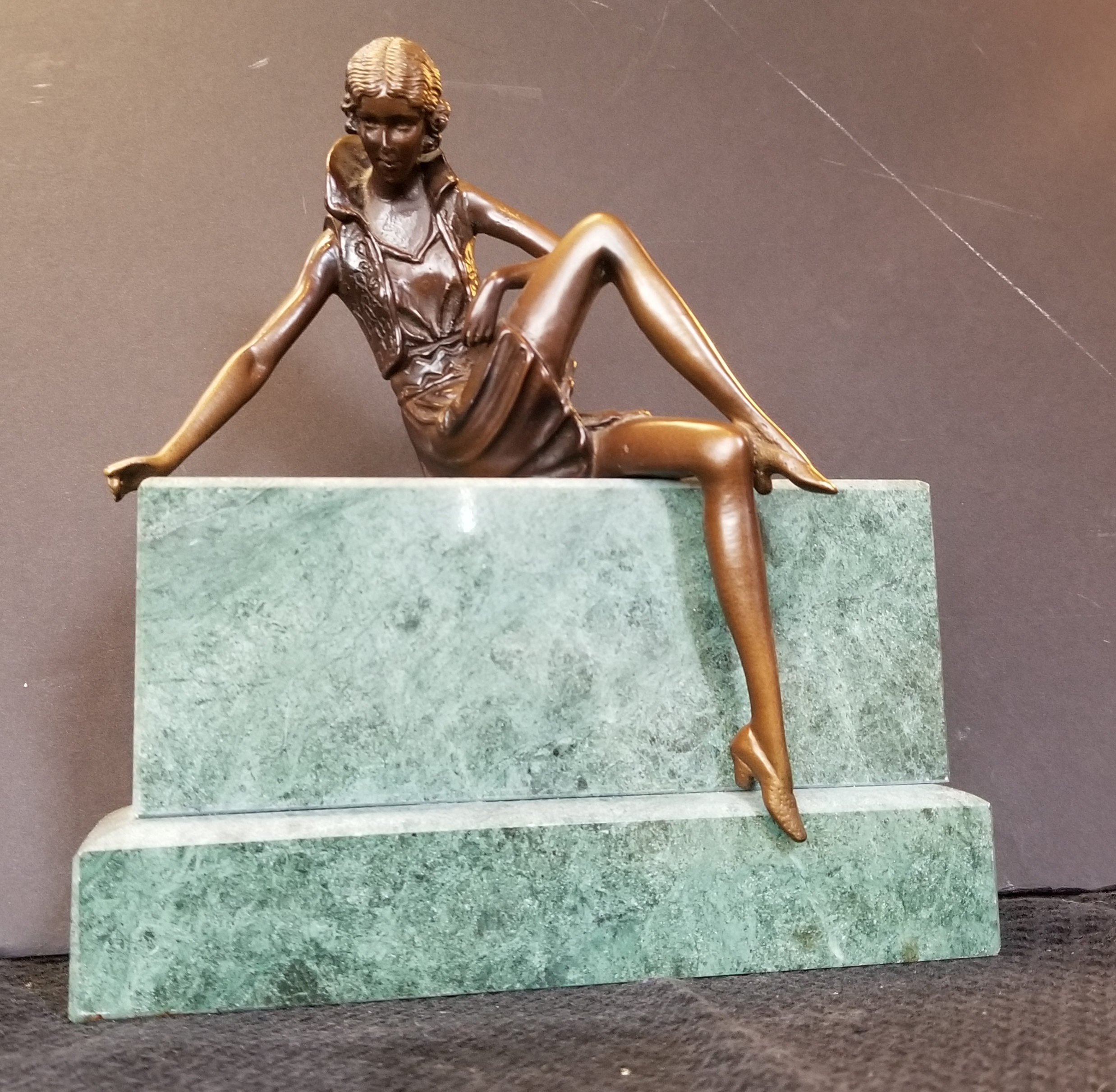 Lady on Sitting on Stone Base