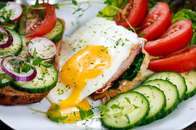 Toasted Egg and Bacon Sandwich with a Mix of Salad and Vegetables Healthy Morning Breakfast Recipe