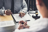 Person discussing a document with a client