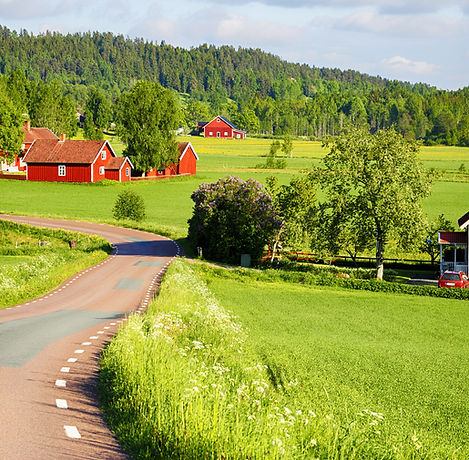 old red farm houses set in a rural lands