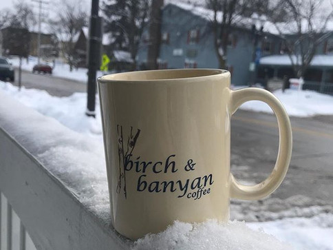 As cold as it is outside, the snow does look beautiful, especially from inside our cozy shop sipping a hot cup of coffee! #birchandbanyancof