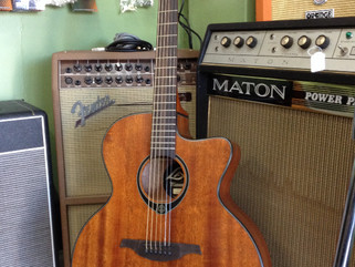 How'd you like to win this here LAG electro/acoustic guitar??