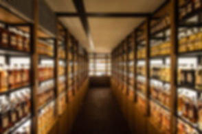 Room full of whisky cabinets storing dif