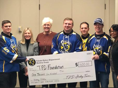 TPD Hockey Team Donates proceeds to Toledo Police Foundation.