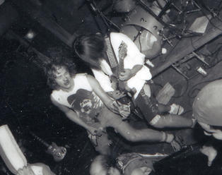 Ottawa 1987-Murray had already broken his arm in a hockey game before Mike Jack broke his nose onstage. Photo by Shawn Scalen.