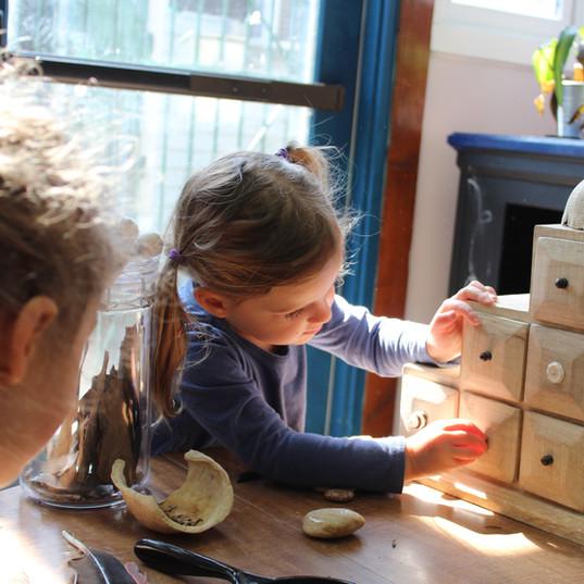 Child explores natural treasures during Wild Haven classes.