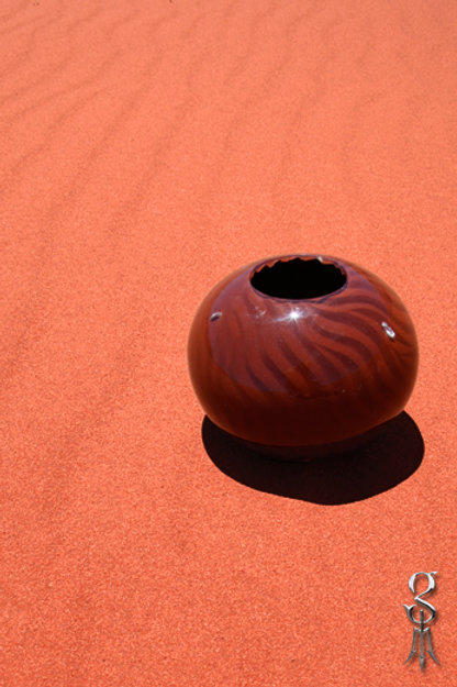 Small round Resin Vase in desert ripple pattern pindan red sand featuring keshi