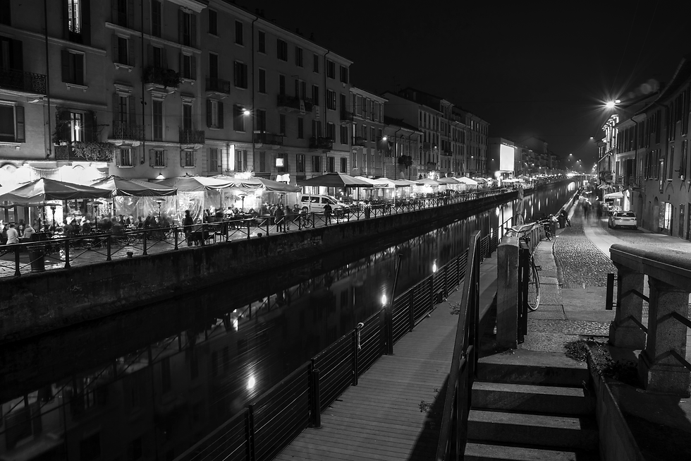 Milan, Italy: the Naviglio Grande canal waterway at evening. This district is famous for its restaurants, cafes, pubs and nightlife.