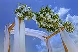 Bamboo wedding arch with fresh flower