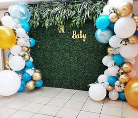 Greenery backdrop with organic balloons