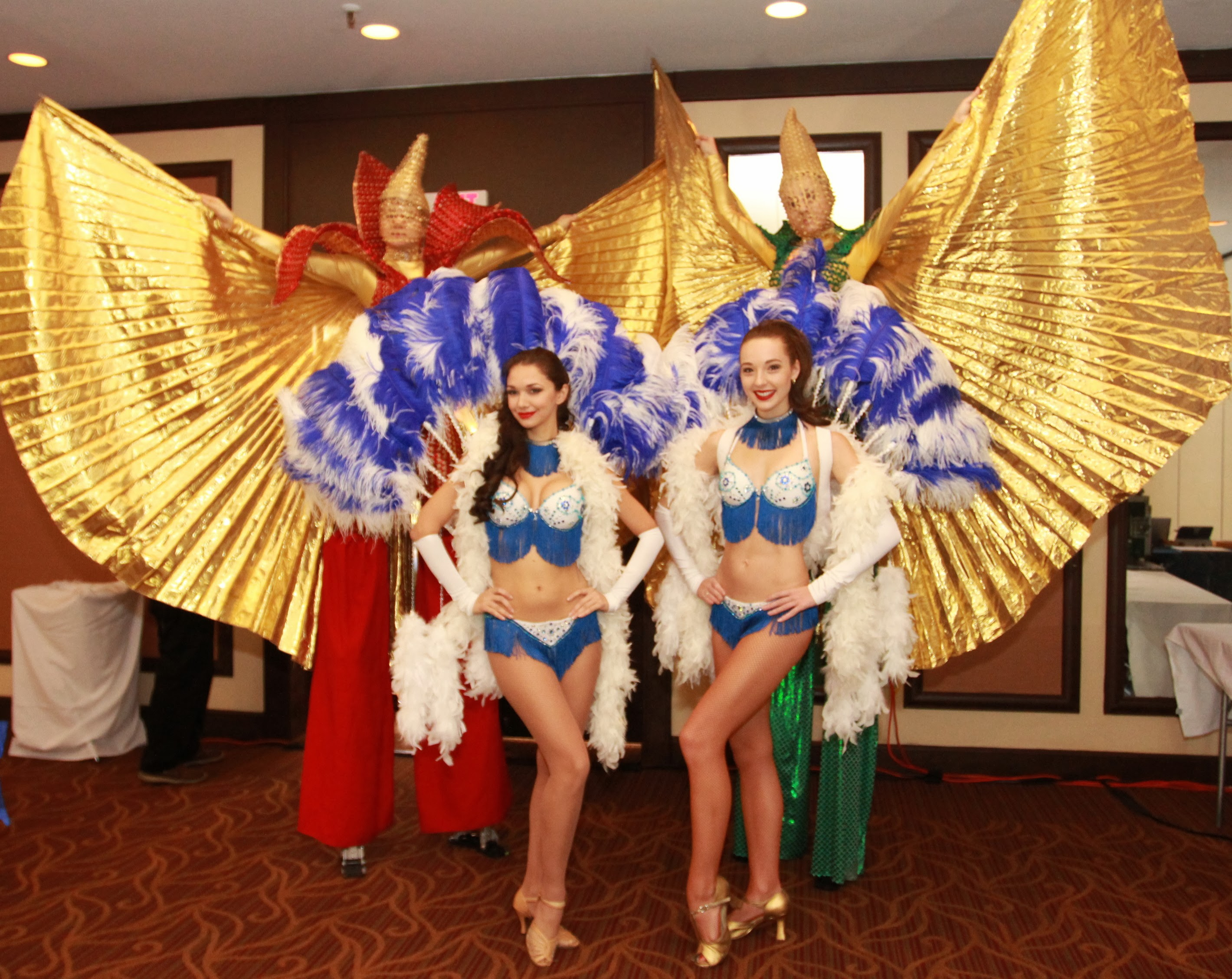 Show Girls and Stilt Walkers