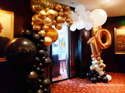 Black, gold, white balloon arch
