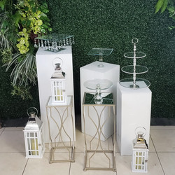 White Pedestals and Greenery Backdrop